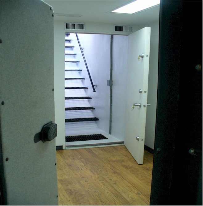 Locations open safe room door with stairwell leading up to house & Below Ground Gun VaultBunkerFallout ShelterGun VaultBomb Shelter