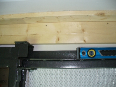 Leveling pocket door frame