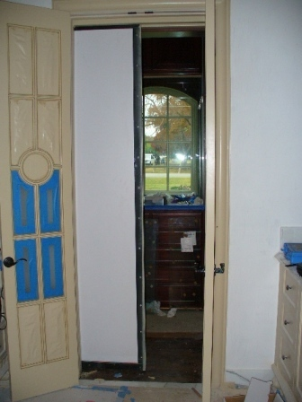 Level 8 Ballistic Pocket Door with remote and motorized actuator