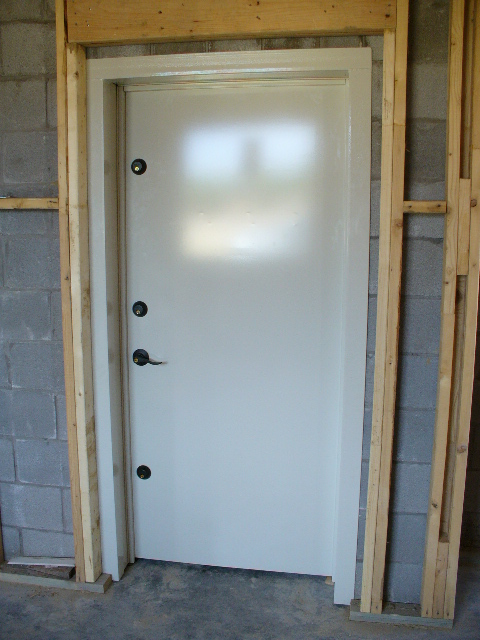 Saferoom door inside view of an f5 storm shelters safe for Custom safe rooms