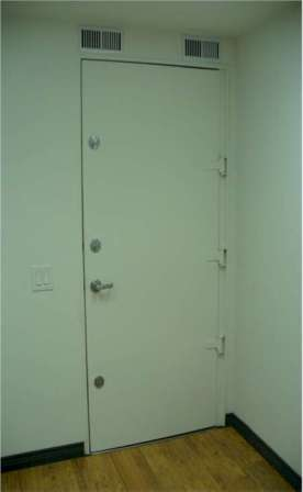 door with triple deadbolts and keyed commercial lock